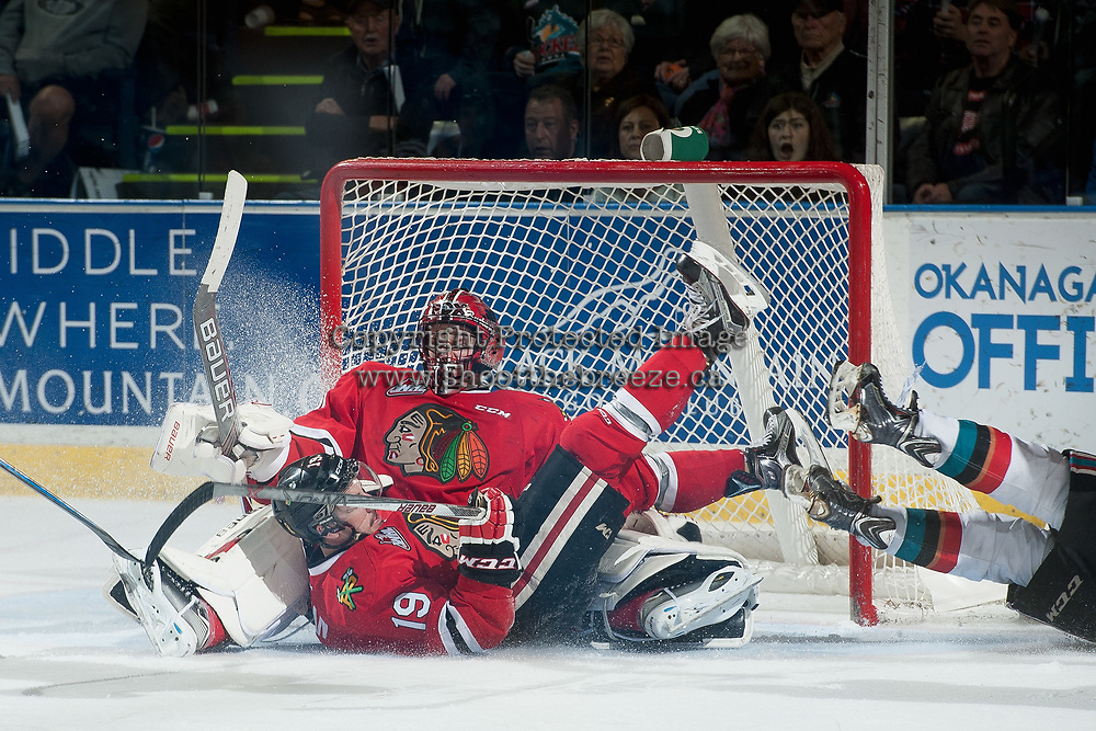 KELOWNA, CANADA - MAY 1: Nicolas Petan #19 trips over Adin Hill #31 of Portland Winterhawks during overtime against the Kelowna Rockets during game 5 of the Western Conference Final on May 1, 2015 at Prospera Place in Kelowna, British Columbia, Canada.  (Photo by Marissa Baecker/Getty Images)  *** Local Caption *** Nicolas Petan; Adin Hill;
