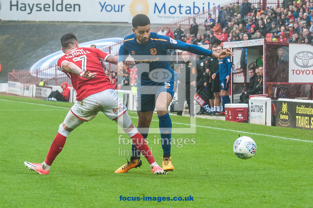 Michael Hector of Hull City tries to find a way past Adam Hammill of Barnsley during the Sky Bet Championship match at Oakwell, Barnsley<br /> Picture by Matt Wilkinson/Focus Images Ltd 07814 960751<br /> 21/10/2017