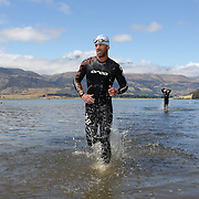 Competitors emerge from the water during the swimming leg of the Paradise Triathlon and Duathlon series, Paradise, Glenorchy, South Island, New Zealand. 18th February 2012. Photo Tim Clayton