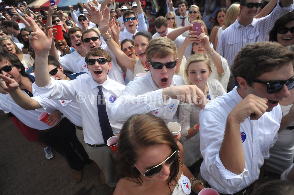 Ole Miss fans cheer as the team walks through the Grove in Oxford, Miss. on Saturday, September 1, 2012. Mississippi hosts Central Arkansas to open the season.