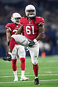 ARLINGTON, TX - AUGUST 26:  Cap Capi #61 of the Arizona Cardinals at the line of scrimmage during a game against the Dallas Cowboys at AT&T Stadium during week 3 of the preseason on August 26, 2018 in Arlington, Texas.  The Cardinals defeated the Cowboys 27-3.  (Photo by Wesley Hitt/Getty Images) *** Local Caption *** Cap Caps