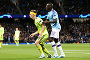 Dinamo Zagreb midfielder Dani Olmo (7) and Manchester City defender Benjamin Mendy (22) during the Champions League match between Manchester City and Dinamo Zagreb at the Etihad Stadium, Manchester, England on 1 October 2019.