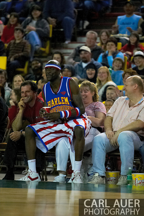 "05 May 2006: Kevin ""Special K"" Daley takes a seat on a fan to watch the Harlem Globetrotters vs the New York Nationals at the Sulivan Arena in Anchorage Alaska during their 80th Anniversary World Tour."