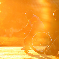 050709_Lusaka, Zambia Melanie Maxwell <br /> Seawell, 36, reaches for the ball as the sun beats down during a sunset game of wheelchair basketball in Lusaka, Zambia on Thursday, May, 7 2009. Seawell, who makes his living fixing up and modifying wheelchairs, is on the national Zambia team and will compete in the upcoming All Africa Games.
