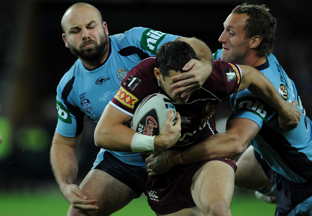 July 6th 2011: Billy Slater of the Maroons is tackled by Glenn Stewart and Mark Gasnier of the Blues during game 3 of the 2011 State of Origin series at Suncorp Stadium in Brisbane, QLD, Australia on July 6, 2011. Photo by Matt Roberts / mattrimages.com.au / QRL