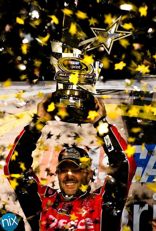 Tony Stewart celebrates winning the Sprint All Star Race Friday night at Lowe's Motor Speedway. Photo by James Nix