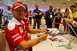 Sebastian Vettel (GER) Ferrari signs autographs for the fans.<br />