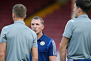 Brendan Rodgers Manager of Leicester City talks to Harry Maguire of Leicester City before the Pre-Season Friendly match between Scunthorpe United and Leicester City at Glanford Park, Scunthorpe, England on 16 July 2019.