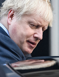 © Licensed to London News Pictures. 19/10/2019. London, UK. British Prime Minister BORIS JOHNSON is seen leaving 10 Downing Street to head to The Houses of Parliament in Westminster, London on the day that Parliament will vote on a new agreement between UK government and the EU over Brexit. Parliament is sitting on a Saturday for the first time since 1982. Photo credit: Ben Cawthra/LNP