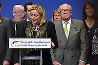LYON, FRANCE - NOVEMBER 30: Marine Le Pen speaks from the podium as her father and party chief predecessor Jean Marie Le Pen looks on from behind at the far-right National Party's 15th congress on November 30, 2014 in Lyon, France. Marine Le Pen won 100 percent backing to remain chief of the party, founded by her father. Marine Le Pen is expected to make a bid for the country's presidency in 2017. (Photo by Bruno Vigneron/Getty Images)