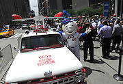 Mr. Met unveils the Good Humor Truck of the future, featuring digital screens, social media capabilities, and popular songs, Thursday, June 25, 2015, in New York. Follow @GoodHumor on Twitter as the Joy Squad travels to other cities this summer. (Diane Bondareff/AP Images for Good Humor)