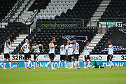 Derby County players during the EFL Sky Bet Championship match between Derby County and Brentford at the Pride Park, Derby, England on 11 July 2020.