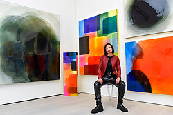 © Licensed to London News Pictures. 25/09/2019. LONDON, UK. Artist Nat Bowen poses with some of her works made using the study of Chromology, the psychology behind colour,  at the preview of START, a contemporary art fair comprising eclectic works from a variety of international emerging artists.  The fair takes place at the Saatchi Gallery in Chelsea 26 to 29 September 2019.  Photo credit: Stephen Chung/LNP