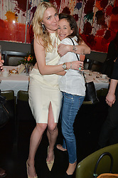 Left to right, JODIE KIDD and LEAH WOOD at the mothers2mothers Mother's Day Tea hosted by Nadya Abela at Morton's, Berkeley Square, London on 12th March 2015.  mothers2mothers is a charity working to eliminate mother to child transmission of HIV/AIDS across sub-Saharan Africa.