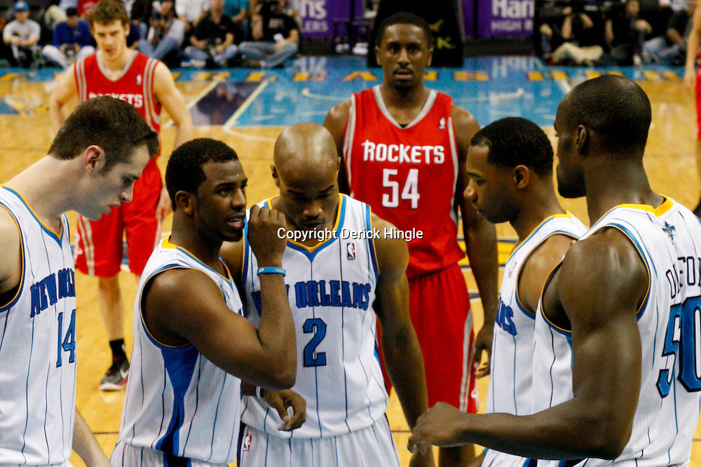 April 6, 2011; New Orleans, LA, USA; New Orleans Hornets players (left to right) Jason Smith, Chris Paul, Jarrett Jack, Willie Green, and Emeka Okafor huddle up before a free throw during the second half against the Houston Rockets at the New Orleans Arena. The Hornets defeated the Rockets 101-93 and clinched a playoff spot with the victory.   Mandatory Credit: Derick E. Hingle-US PRESSWIRE