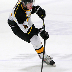 AURORA, ON - Jan 11 : Ontario Junior Hockey League Game Action between the Lindsay Muskies and the Aurora Tigers, Callum Fryer #4 of the Aurora Tigers Hockey Club shoots the puck.<br /> (Photo by Brian Watts / OJHL Images)