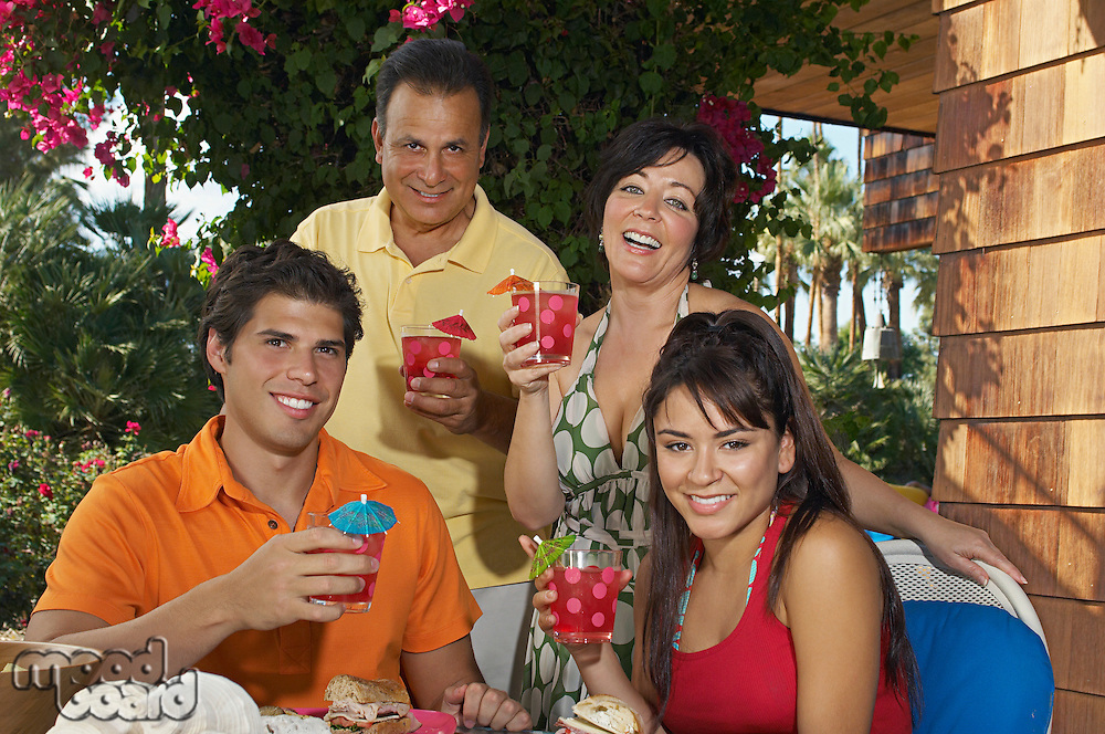 Family with drinks in garden