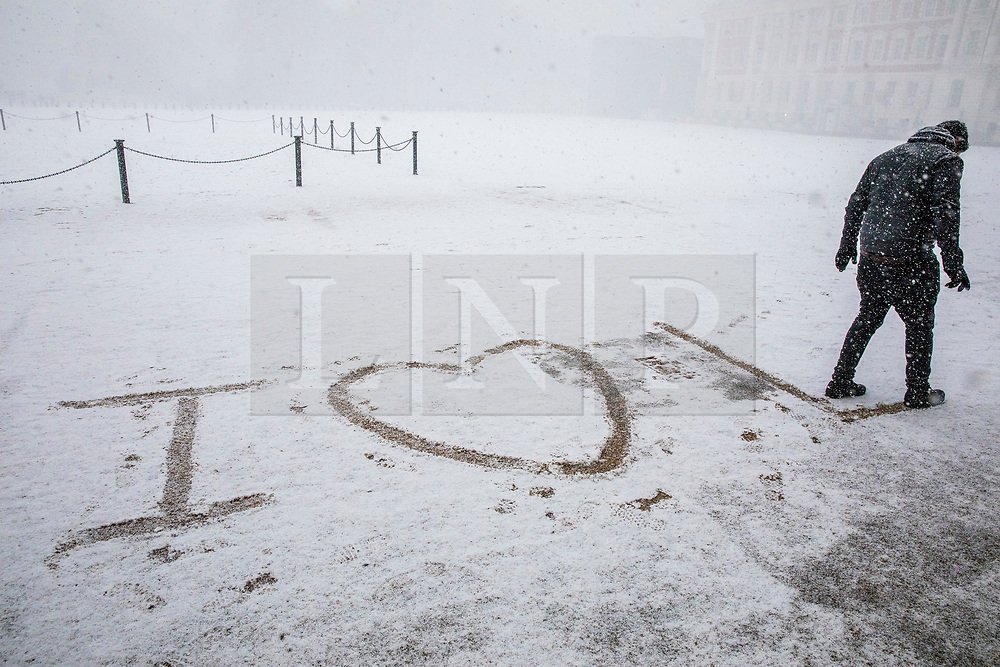 © Licensed to London News Pictures. 27/02/2018. London, UK. A tourist writes 'I LOVE LDN' in the snow on Horse Guards Parade as heavy snow falls in central London. Severe cold, blizzards and heavy snow are expected for the rest of the week as the 'Beast from the East' brings freezing Siberian air to the UK. Photo credit: Rob Pinney/LNP