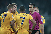 Andrew Madley (Referee) speaks to the Preston players having awarded a penalty during the EFL Cup 4th round match between Newcastle United and Preston North End at St. James's Park, Newcastle, England on 25 October 2016. Photo by Mark P Doherty.