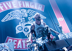 © Licensed to London News Pictures. 01/12/2013. London, UK.   Five Finger Death Punch performing live at Wembley Arena, supporting headliner Avenged Sevenfold.  In this pic - Ivan Moody. Five Finger Death Punch (also known as FFDP or 5FDP) is an American heavy metal band from Los Angeles, California, consisting of members Ivan Moody (lead vocals), Zoltan Bathory (rhythm guitar), Jeremy Spencer (drums), <br /> Jason Hook (lead guitar/vocals), Chris Kael (bass guitar/vocals).  Photo credit : Richard Isaac/LNP