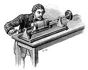 Making recording on first model of Edison's Phonograph. Here tinfoil cylinder on which recording was made had to be turned by  hand. From Th. Du Moncel 'Le Telephone, le Microphone et le Phonograph', Paris, 1878