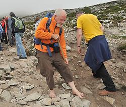 Barefoot Pilgrim Joseph Keaney from Drumshambo Co Leitrim on Croagh Patrick yesterday.<br /> Pic Conor McKeown