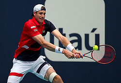 John Isner, of the United States, returns to Roger Federer, of Switzerland, during the final of the Miami Open tennis tournament at Hard Rock Stadium on Sunday, March 31, 2019, in Miami Gardens, Fla. Roger Federer won 6-1, 6-4. Photo by David Santiago/Miami Herald/TNS/ABACARESS.COM