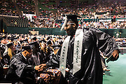 Students congratulate each other during the morning Undergraduate Commencement ceremony on Saturday, May 2, 2015.  Photo by Ohio University  /  Rob Hardin