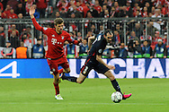 Thomas Mueller of Bayern Munich and Diego Godin of Atletico Madrid during the UEFA Champions League match at Allianz Arena, Munich<br /> Picture by EXPA Pictures/Focus Images Ltd 07814482222<br /> 03/05/2016<br /> ***UK &amp; IRELAND ONLY***<br /> EXPA-EIB-160503-0073.jpg