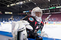 KELOWNA, CANADA - OCTOBER 23:  James Porter #1 of the Kelowna Rockets throws the pucks onto the ice for warm up against the Swift Current Broncos on October 23, 2018 at Prospera Place in Kelowna, British Columbia, Canada.  (Photo by Marissa Baecker/Shoot the Breeze)