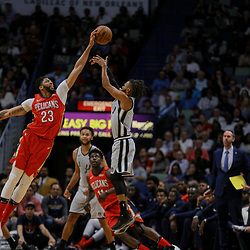 Apr 11, 2018; New Orleans, LA, USA; New Orleans Pelicans forward Anthony Davis (23) blocks a shot by San Antonio Spurs guard Patty Mills (8) during the first quarter at the Smoothie King Center. Mandatory Credit: Derick E. Hingle-USA TODAY Sports