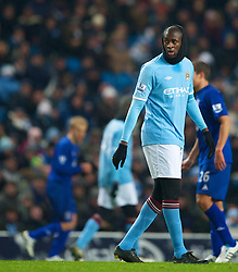 MANCHESTER, ENGLAND - Monday, December 20, 2010: Manchester City's Yaya Toure wears a head covering snood scarf in temperatures approaching -14 degrees centigrade during the Premiership match against Everton at the City of Manchester Stadium. (Pic by: David Rawcliffe/Propaganda)