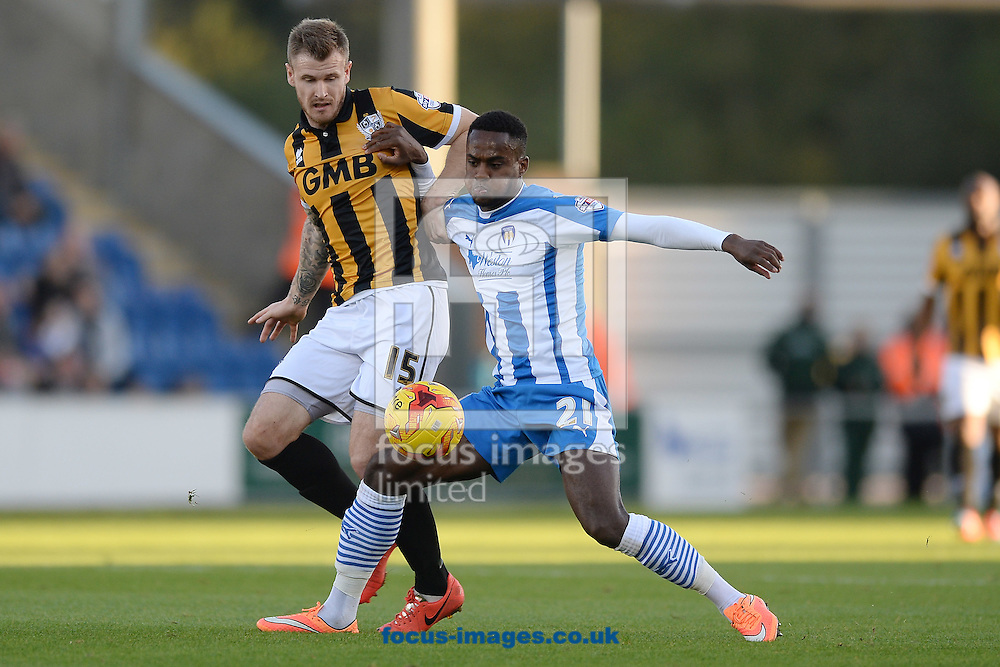 Gavin Massey of Colchester United looks to get past Michael O'Connor of Port Vale during the Sky Bet League 1 match between Colchester United and Port Vale at the Weston Homes Community Stadium, Colchester<br /> Picture by Richard Blaxall/Focus Images Ltd +44 7853 364624<br /> 01/11/2014