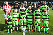 Mascots and captains during the EFL Sky Bet League 2 match between Forest Green Rovers and Cheltenham Town at the New Lawn, Forest Green, United Kingdom on 20 October 2018.