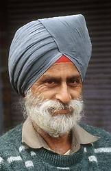 Portrait of elderly man wearing turban,
