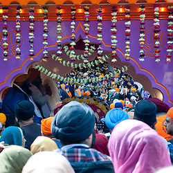 London, UK - 7 April 2013: Sikhs devotees gathers aroung the float to pay their tribute to the holi scripture