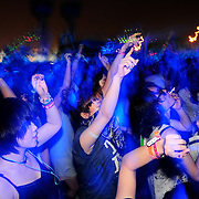 People dance at an outdoor venue at the Pentaport International Rock Festival
