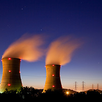 USA, Pennsylvania, Middletown, Steam vents from cooling towers at Three Mile Island nuclear power plant at dusk on spring evening