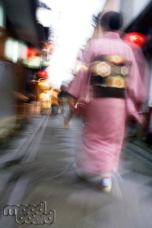 Japan Kyoto Pontocho-dori Woman wearing kimono walking on narrow street motion blur