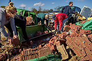 Volunteers help remove remnants of a destroyed home on Wednesday, March 1, 2017, in Perryville, Mo. A violent tornado ripped through parts of the area the night before. LCMS Communications/Erik M. Lunsford