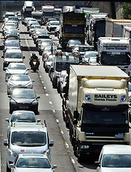 © Licensed to London News Pictures.25/08/2017.<br /> Dartford,UK. M25 ANTICLOCK-WISE between J2 and J3.<br /> M25 August Bank holiday traffic hell with miles and miles of traffic in Kent as thousands of family's get away for a long weekend.<br /> Photo credit: Grant Falvey/LNP