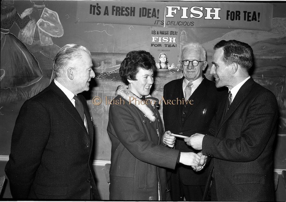 03-04/03/1964<br /> 03/03-04/1964<br /> 03-04 March 1964<br /> B.I.M. Fish Cookery Competition, Munster final, winners at the Metropole Hotel, Cork. The competition was held at the School of Commerce Cork. Photo Shows: Mr. T.F. Geoghegan, Market Development Manager, B.I.M., presenting the 1st prize to Miss Phyllis Cliffe, Vocational School, Dungarvan, also in picture are Mr. J. O'Keeffe, District Inspector, B.I.M and Mr. Denis Mortell, Chairman, Cork City and County Retail Fish Traders Association.