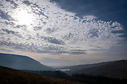 Landscape view across the valley from Glyn Tarell hills in the Brecon Beacons National Park, Wales, Powys, United Kingdom. The Upper Neuadd Reservoir is in the distance. The sun is hidden behind white clouds. The Brecon Beacons are a hill and mountain range in South Wales. The National Park was established in 1957 due to the spectacular landscape which is rich in natural beauty.  (photo by Andrew Aitchison / In pictures via Getty Images)
