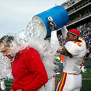 With seconds remaining in ISU's upset win over Kansas State in Manhattan, coach Dan McCarney gets doused by Gerry Gair on the ISU sidelines.  photo by David Peterson