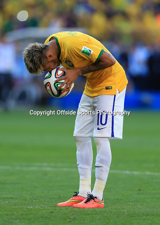 28th June 2014 - FIFA World Cup - Round of 16 - Brazil v Chile - Neymar of Brazil kisses the ball before taking his penalty - Photo: Simon Stacpoole / Offside.