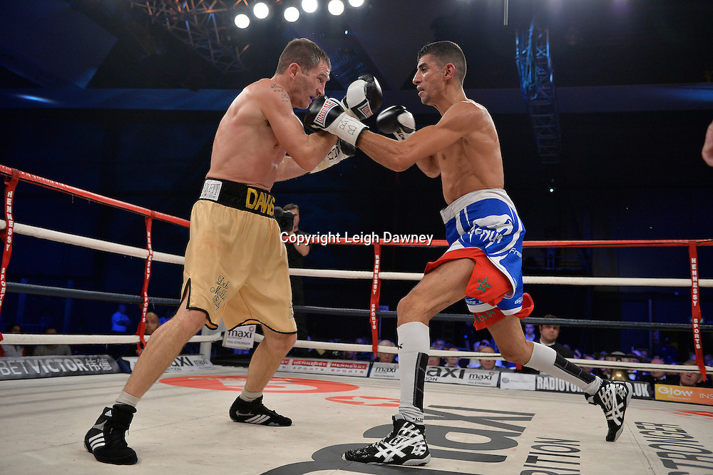 Lenny Daws (left) v Chaquib Fadli fight for the Vacant EBU Light Welterweight Title at Glow, Bluewater, Kent on the 8th November 2014. Promoter: Hennessy Sports. © Leigh Dawney Photography 2014.