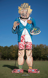 © Licensed to London News Pictures. 31/10/2018. Edenbridge, UK. An effigy of former foreign secretary Boris Johnson as it is unveiled in Edenbridge, Kent ahead of its burning at the town's bonfire this Saturday. The 10 meter high figure stands over two EU referendum buses and Boris is also carrying an EU cake. Photo credit: Peter Macdiarmid/LNP