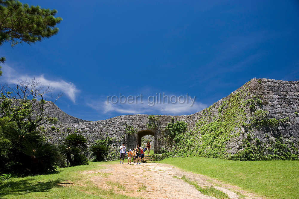 Visitors exit the main gate at Zakimi Castle ruins in Yomitan VILLAGE, Okinawa Prefecture, Japan, on May 20, 2012. Built between 1416 and 1422 by the renowned Ryukyuan militarist Gosamaru, Zakimi Castle oversaw the northern portion of the Okinawan mainland. Photographer: Robert Gilhooly