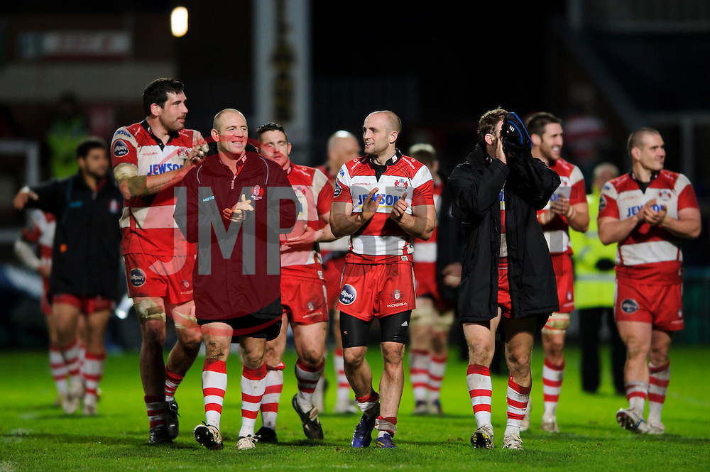 Gloucester Outside Centre (#13) Mike Tindall leads his teammates on a lap of honour after his sides emphatic victory in the match - Photo mandatory by-line: Rogan Thomson/JMP - Tel: Mobile: 07966 386802 15/12/2012 - SPORT - RUGBY - Kingsholm Stadium - Gloucester. Gloucester Rugby v London Irish - Amlin Challenge Cup Round 4.