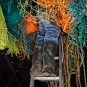 A fisherman inside the loft of his lock-up retrieving new nets to go trawling. Folkestone, Kent, United Kingdom. (photo by Andrew Aitchison / In pictures via Getty Images)